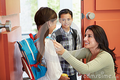 Mother Saying Goodbye To Children As They Leave For School