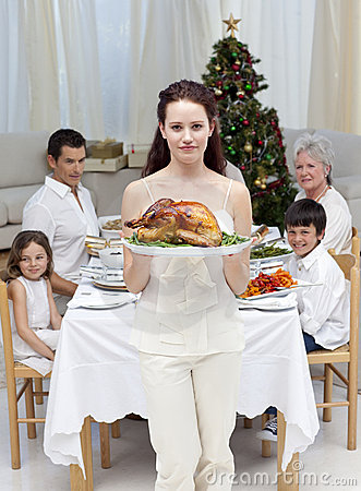 Mother showing turkey for Christmas dinner
