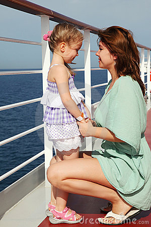 Mother sitting near daughter on cruise liner