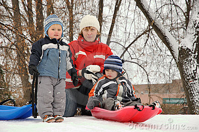 Mother sledding with her children