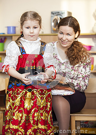 Mother and small daughter in Russian traditional sarafan