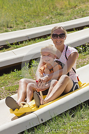 Mother and son on a alpine coaster ride
