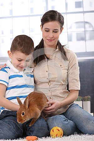 Mother and son with bunny pet