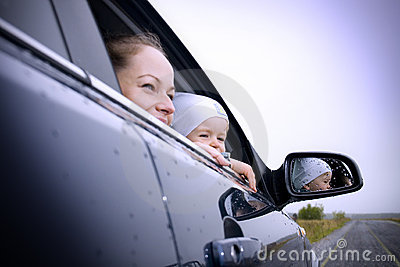 Mother and son in a car