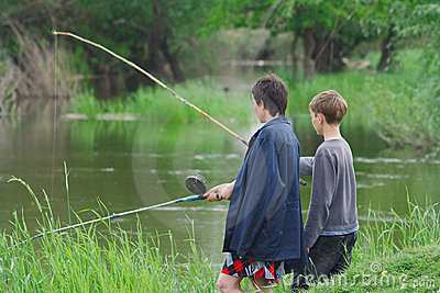 Mother and son catch the fish