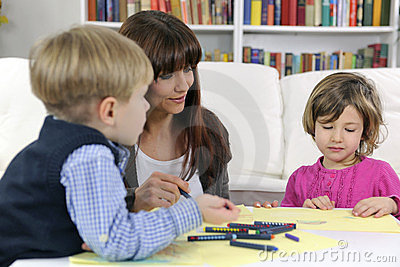Mother, son and daughter drawing Stock Photo