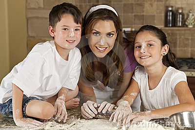 Mother Son & Daughter Family In Kitchen Baking