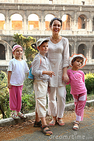 Mother, son and daughters are near Colosseum