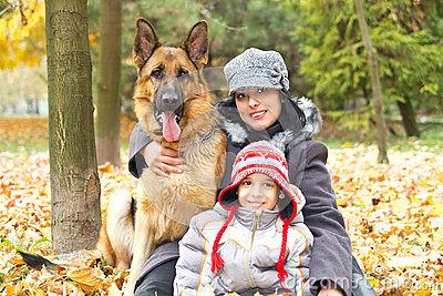 Mother and son with dog in park