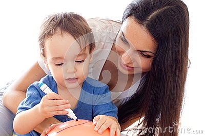 Mother and son drawing picture on balloon