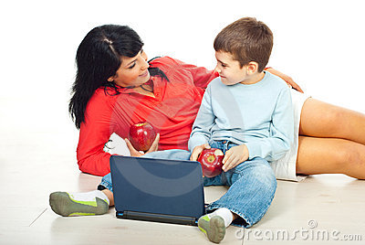 Mother with son eating apples and discuss