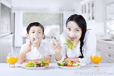 Asian family eathing healthy salad at home