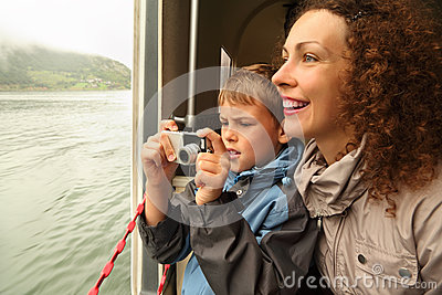 Mother with son float at passengers vessel