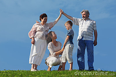 Mother and son, grandparents making house roof Stock Photo