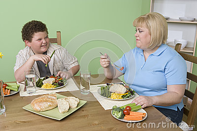 Mother And Son Having Food