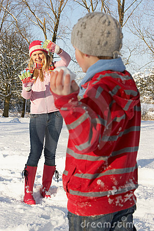 Mother And Son Having Snowball Fight