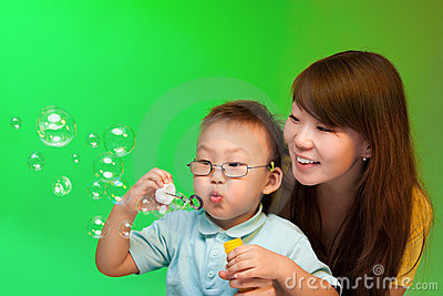 Mother and son make soap bubbles