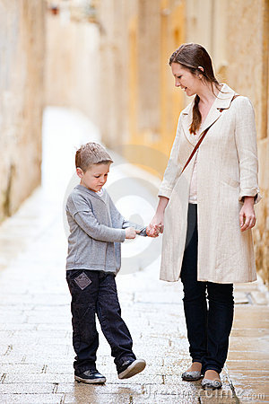 Mother and son outdoors in city