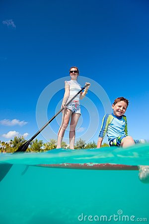 Mother and son on a paddle board