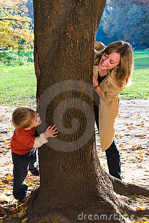 Mother and son play hide-and-seek