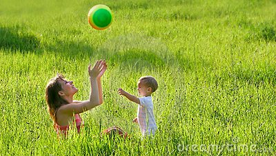 Mother and son playing with ball