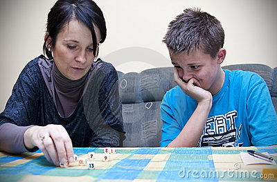 Mother and son playing dice