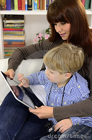 Mother and son playing with digital tablet