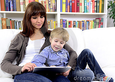 Mother and son playing with digital touchpad
