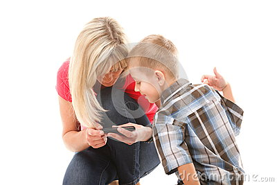 Mother and son playing video game on smart phone