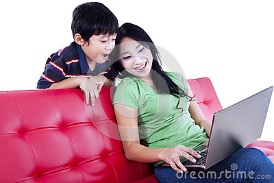 Mother and son quality time on red sofa - isolated