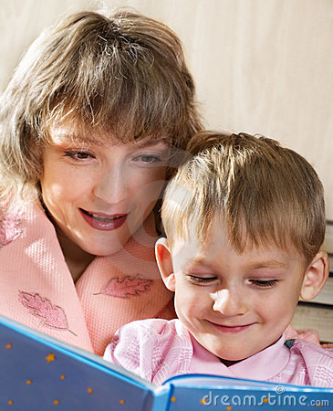 Mother and son read book