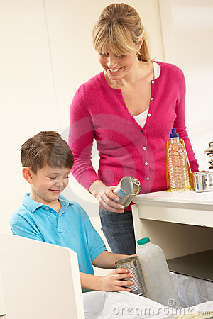 Mother And Son Recyling Waste At Home