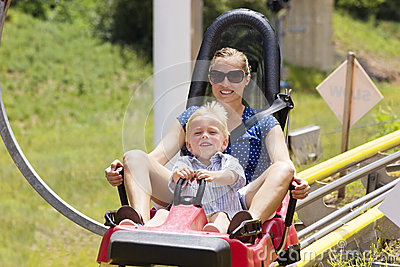 Mother and son on a roller coaster ride