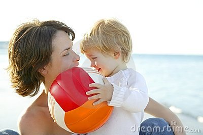 Mother and son on the sea, football ball