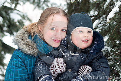 Mother and son in  spruce forest