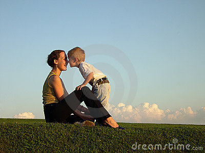 Mother with son on sundown kiss by nose
