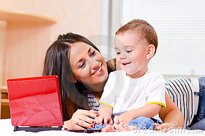 Mother and son are using laptop