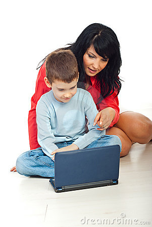 Mother and son using notebook