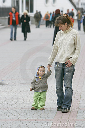 Mother and son walking