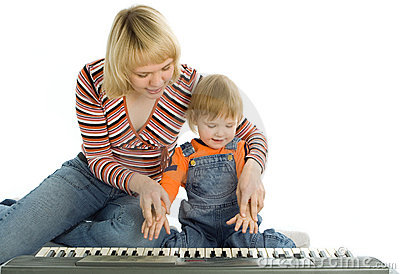 Mother teach  baby play piano
