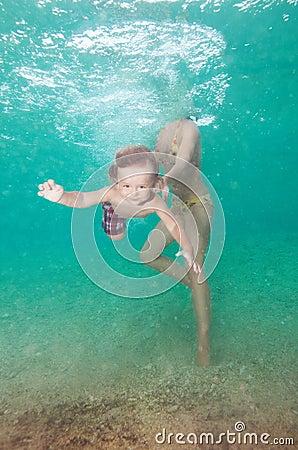Mother teach little son to swim
