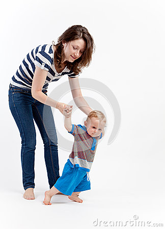 Mother teaching baby to walk