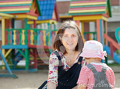 Mother with  toddler  in sandbox