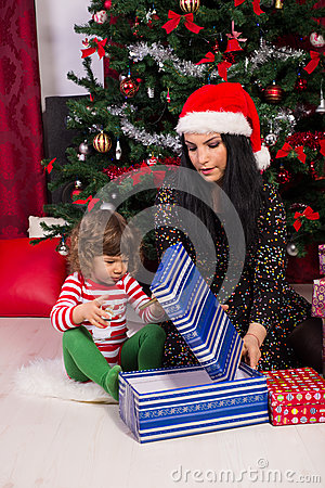 Mother and toddler son open christmas gift stock photo Christmas gift ideas for mom from son