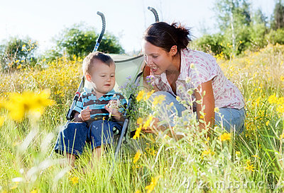 Mother and toddler son outdoors