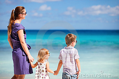 Mother and two kids at beach