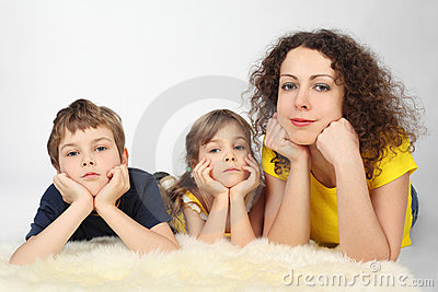 Mother with two serious children lies on fell
