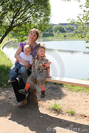 Mother and two sons by lake