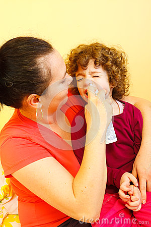 Mother using spray to cure