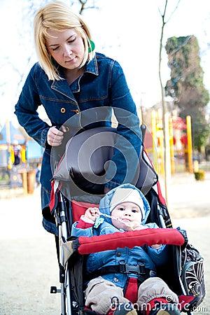 Mother walking baby